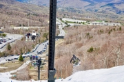 A skier jumps off a mogul underneath the Snowshed chairlift at Killington Resort